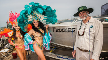 Elwood Angling Club named its boat Teddles after veteran member Ted Wilkinson (right) who posed with Latin dancers from DanceCity Productions at the St Kilda Festival.