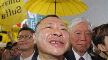 Occupy Central leaders, from left, Chan Kin-man, Benny Tai and Chu Yiu-ming enter a court in Hong Kong on Wednesday.
