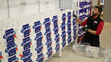 A worker restocks a shelf at one of Coles' Melbourne supermarkets on Thursday night.