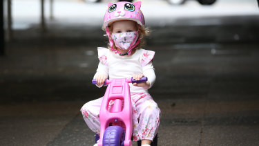 Elodie wears a mask as she rides her bike in Brisbane on Saturday, January 9, during the three-day lockdown.