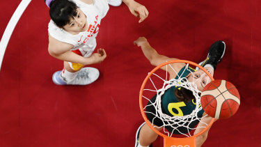 Steph Talbotof Team Australia and Yueru Li of Team China watch the ball on the rim on the basket during the first half.