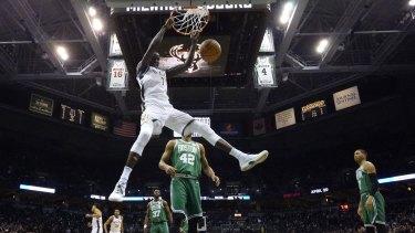 The Bucks' Thon Maker dunks against Boston in game six.