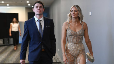 Glitz and glamour: Lachie Neale and his wife Julie arrive at The Gabba stadium in Brisbane for the AFL's virtual best and fairest count.