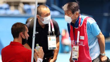 Daniil Medvedev receives medical attention on Wednesday.