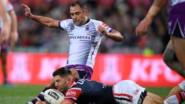 Storm captain Cameron Smith and James Tedesco compete for the ball during the NRL preliminary final between Melbourne and the Sydney Roosters.