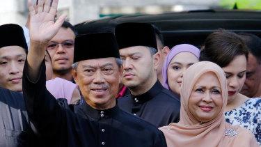 Malaysian PM Muhyiddin Yassin, left.