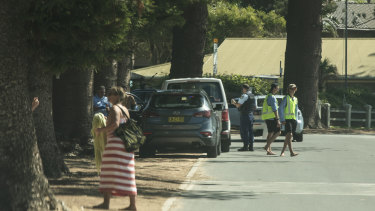 Police pull over a car on Ocean Road at Palm Beach. The government has asked that people stay at their primary residence over the Easter long weekend due to the coronavirus.