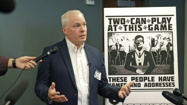 Chris Ingalls, an investigative reporter with KING-TV in Seattle, talks to reporters about the poster, reproduced at right, that was mailed to his home earlier this year.