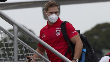 Jack de Belin boards a flight to Queensland with his Dragons teammates on Wednesday.