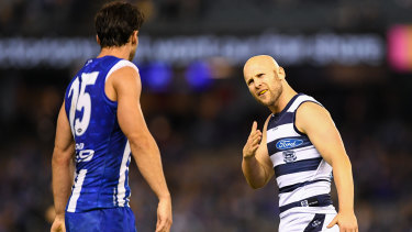Gary Ablett (right) has words with North Melbourne defender Robbie Tarrant.