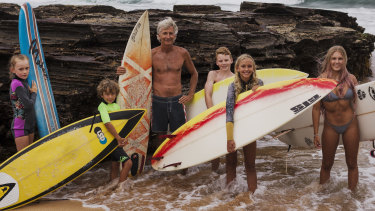 Adriaan van der Wallen, centre, with surfers including Blaze Roberts (right) and Josh Leigh (yellow and white board).