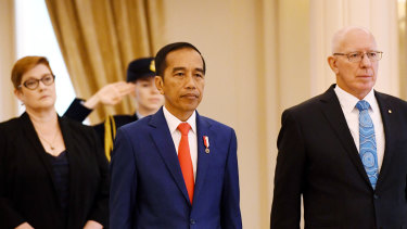 Governor-General David Hurley, right, greets Indonesian President Joko Widodo as he receives a ceremonial welcome.