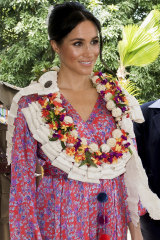 The Duchess of Sussex wore a silk Figue Frederica printed ruffle dress and a clutch bag oflocally-made tapa barkcloth in Suva, Fiji.