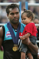 Football family: Kozzi's uncle Byron won the Norm Smith Medal in 2004.