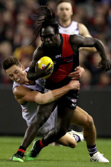 Essendon's Anthony McDonald-Tipungwuti powers through against Fremantle on Saturday night.