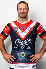 Roosters captain Boyd Cordner wearing the team's World Club Challenge jerseys with NSW RFS insignia.