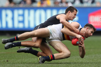 Andy Otten is tackled in round 19 against Carlton.
