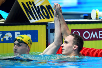 Australia's Matthew Wilson congratulates Anton Chupkov of Russia after he set a new world record at the 2019 FINA World Championships.