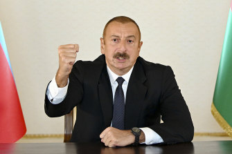 Azerbaijani President Ilham Aliyev gestures as he addresses the nation in Baku, following the clashes.