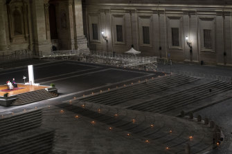 Pope Francis presides over a ceremony in a deserted St Peter's square on Good Friday.