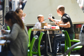 Outdoor dining tables have popped up on Bourke Street outside the Village Centre Arcade.