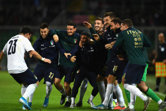 Riccardo Orsolini celebrates his goal on debut for Italy.
