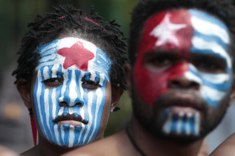 Papuan activists with their face painted in the colours of the separatist Morning Star flag rally in Jakarta last year.