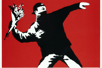 Banksy's Love Is In The Air (2003), was auctioned on Wednesday.