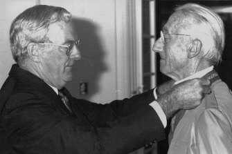 Captain Jacques Yves Cousteau gets investiture of Honorary award from Gov. Gen. Bill Hayden in Canberra Today. February 20, 1990.