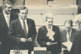 In 1994, former Liberal leader John Hewson watches on as Tony Abbott and Bronwyn Bishop are sworn in.