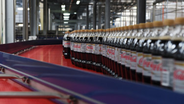 Bottles of caffeine-free Diet Coke move along a conveyor belt at a Coca-Cola Amatil production facility in Melbourne.