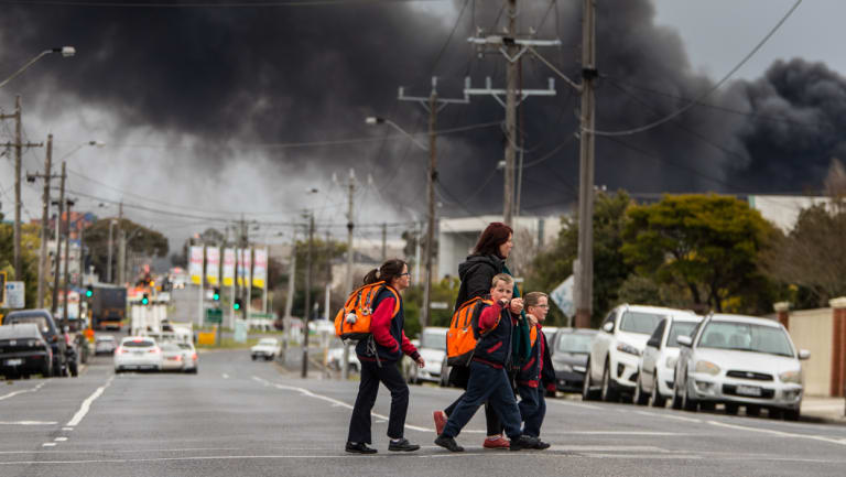 Students from Kingsville Primary school are being taken home after the school was closed due to a huge factory fire in the Western suburbs of Melbourne.