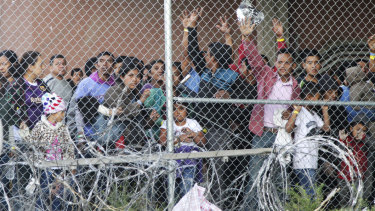Central American migrants wait for food in a pen erected by US Customs and Border Protection to process a surge of migrant families and unaccompanied minors in El Paso, Texas, in March.