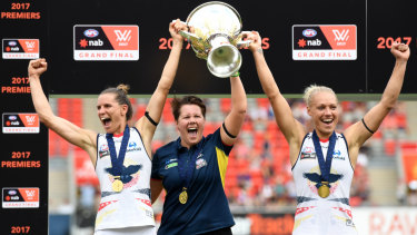 Bec Goddard, centre, led the Adelaide Crows to the inaugural AFLW title.