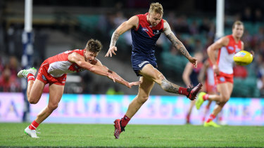 Catch me if you can: Melbourne's James Harmes scores a goal in the win that condemned the Swans to a 1-3 start to the AFL season.