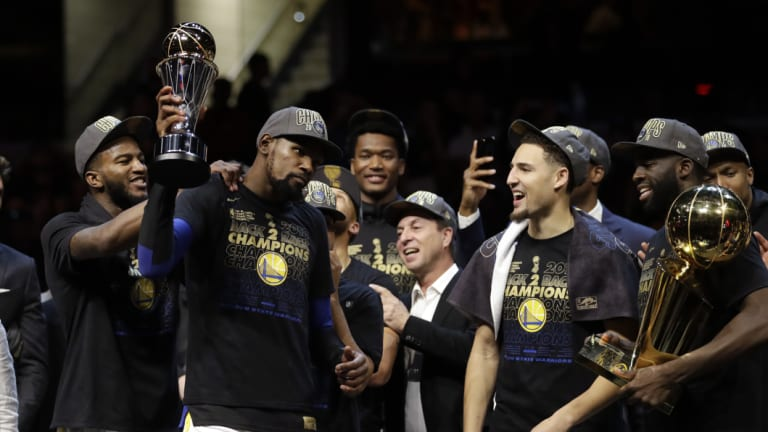 Golden boys: Kevin Durant, second from left, celebrates after the Warriors defeated the Cavaliers.