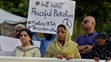 Members of a civil society group condemn a suicide bombing in Islamabad on Saturday in Pakistan\'s troubled election campaign.