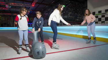 Madison Hooper, Riley Element, Jessica Element and Chloe Carpenter mid-skate.