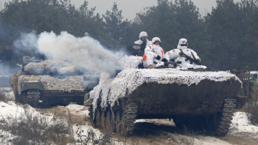 Ukrainian soldiers move to position during military drills in base Honcharivske, Chernihiv region, Ukraine, Monday.