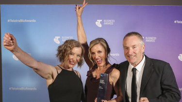 Scoot Boots at the Telstra Australia Business Awards: from left, Scoot Boots staff member, AnnetteKaitinis and David MacDonald.