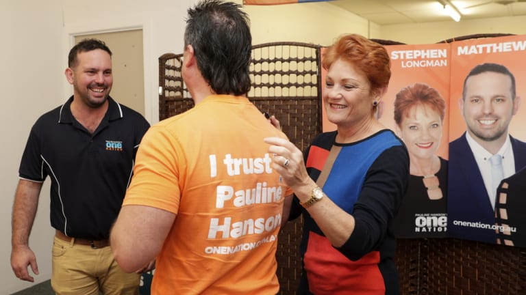One Nation supporter Paul Henselim has his campaign T-shirt signed by Pauline Hanson in Caboolture, Queensland.