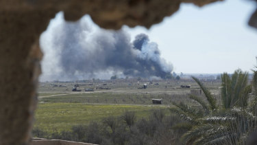 Columns of black smoke billow from the last small piece of territory held by Islamic State militants as US backed fighters pounded the area with artillery fire and occasional airstrikes in Baghouz, Syria, on Sunday.