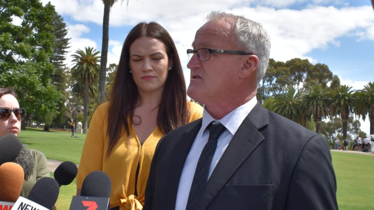 Peter Miller, with his daughter Tegan Connor, talks to the media about the suicide of his son Rhys Connor in a FIFO accomodation camp.