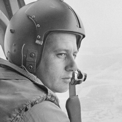 Flight Lieutenant Bob Grandin at the controls of an RAAF helicopter during the Vietnam War.