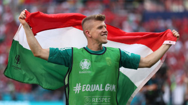 David Siger of Hungary celebrates with a flag following the UEFA Euro 2020 Championship Group F match  win against France.