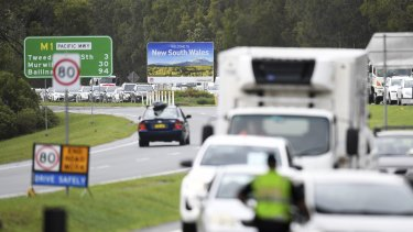 Vehicles arriving from New South Wales queuing to cross the Queensland border at Coolangatta.