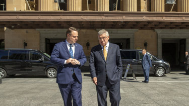IOC president Thomas Bach (right) and Brisbane Lord Mayor Adrian Schrinner are seen taking a quick tour outside the Brisbane City Hall.