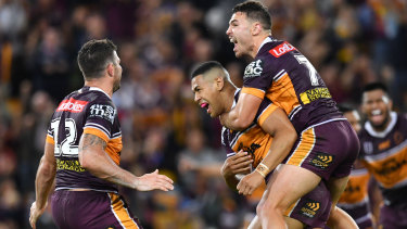 Brisbane celebrate after Jamayne Isaako lands a game-winning field goal against Parramatta in round 24.