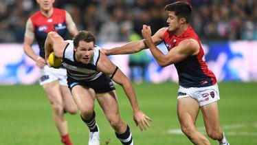 Geelong's Patrick Dangerfield breaks free of Melbourne's Alex Neal-Bullen.