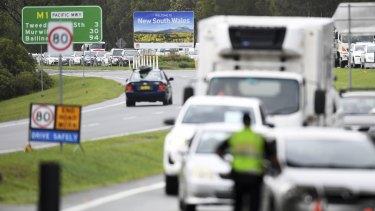 Vehicles arriving from New South Wales queuing to cross the Queensland border at Coolangatta on Monday.